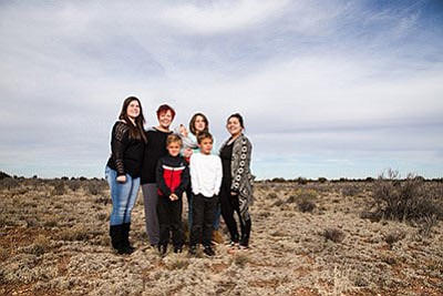 Sue Winchester (center) with her adopted and foster children stand on their property in Valle, where Bella's Place will be built. From left: Jessica Ross-Mentor, Gunner, Kaylee and Alexus. Front: Seven-year-old twins Matthew and Gary Bond. (RYAN WILLIAMS/WGCN)