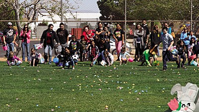 JC AMBERLYN/Miner<br>Children charge the field at the start of Saturday's annual Easter Egg Hunt at Centennial Park.