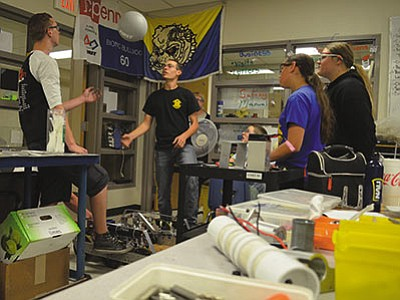 Students with the Kingman FIRST (For Inspiration and Recognition of Science and Technology) Robotics Team 60 launch a foam ball as part of a test of modifications to a robot being built for regional and national competitions. Students from Kingman Unified School District, Kingman Academy of Learning, Mohave Community College and home-schooled children participate in the program. (AARON RICCA/Miner)