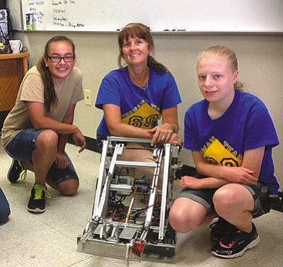 Kingman Academy Middle School eighth-grade science teacher Celeste Lucier, middle, with Kingman FIRST Robotics Team 60 students Serenity Shelby, left, and Rebecca Leggett. (Courtesy)