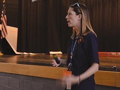 Arizona Attorney General Community Outreach Coordinator Brittany Jick talked to parents and teachers about Internet safety and security at White Cliffs Middle School recently. (AARON RICCA/Miner)