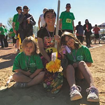 Dig It Kingman Community Gardens: Amelia Brackett, Madi and Peyton show off their awards at the Dig It Dash on April 2. It was a huge success! Thank you to the sponsors as well as those who provided in-kind donations and services. Also thanks to all the wonderful runners and walkers who participated. It was a fun event! DIKCG appreciates your support of the garden. Our monitor shed will be built soon because of all your generosity. (Courtesy)
