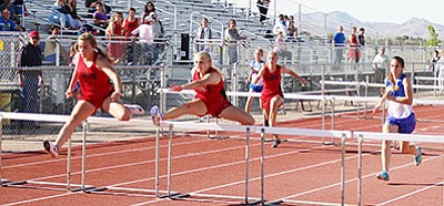 SHAWN BYRNE/Miner<br> Lee Williams's Trysta Rucker, left, leads the way in the girls 100 hurdles Wednesday at Kingman High School. Rucker's teammate Lillian Rapp was second, Kingman's Courtney Mossor, right, finished third. In back, LWHS' Alexis Hoffman and Heather Melius fight to get to the front.