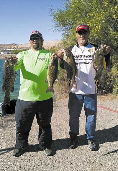 Courtesy<br> Brian Novelo (left) and Shane Moline hold some of the smallmouth bass they caught that earned them $2,300 at a recent Wild West Bass Tournament at Lake Mohave.