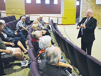 Arizona Corporation Commissioner Andy Tobin addresses an audience full of Valle Vista residents. (AARON RICCA/Miner)