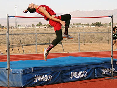 Giancarlo Narvarte clears 6 feet, 4 inches in the high jump at the Kingman Multi on April 6. Narvarte won Saturday's Route 66 Invitational, going over the bar at 6-6. (SHAWN BYRNE/Miner)