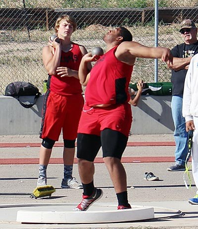 Kensington Penny competes in the shot put April 13 at Lee Williams High School. Penny was fifth for the Vols at the Knights of Columbus Invitational at Bourgade Catholic Saturday in Phoenix. (SHAWN BYRNE/Miner)