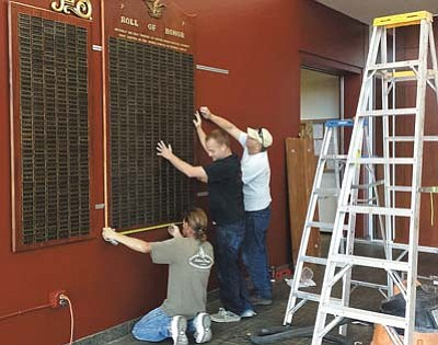 Employees from Stutler Cabinets assemble the newly refurbished WWII Memorial at the Mohave County Administration Building. JEAN BISHOP/Courtesy