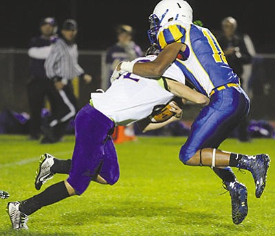 Kingman's Damon Heidorf brings down a Wickenburg ball carrier during the Bulldogs' final game last year. Heidorf is expected play a major role for the Bulldogs this season. (RYAN ABELLA/Miner)