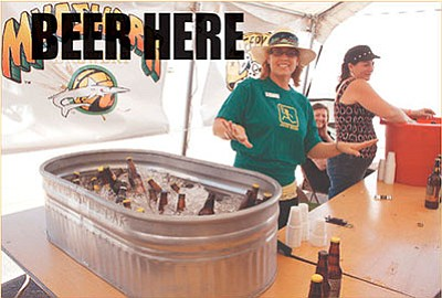 From left, Danielle Sorace of the Mohave County Fair Association Board of Directors, Mary Brock and Renee Carlson helped provide Mudshark beer samples during the 2013 Beerfest. The Fourth Annual Beerfest is from 4 to 8 p.m. Saturday at the fairgrounds. Mudshark Brewery is located in Lake Havasu City.(JC AMBERLYN/Miner)