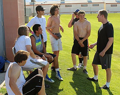 KHS football coach Cam Wierson, far right, speaks to his Bulldogs during  Friday's voluntary workouts. (SHAWN BYRNE/Miner)
