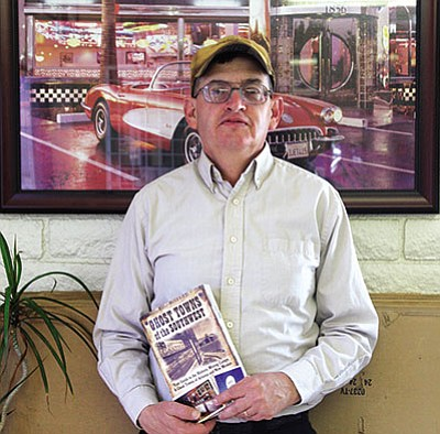 "Jim Hinckley with a copy of his book ""Ghost Towns of the Southwest."" (JC AMBERLYN/Miner)"