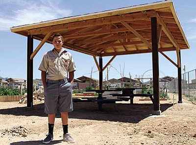 Garrett Hoffman, 14, stands in front of his Eagle Scout project, a Ramada at the Dig It Kingman Community Gardens. (JC AMBERLYN/Miner)