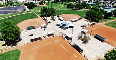 "Centennial Park hosts the 2016 Girls Amateur Softball Association 12U (12-and-under) Girls Fast Pitch Class ""B"" Western National Championship from July 26-31. Tournament officials conservatively estimate 35 teams and more than 2,000 family members to be in attendance. (MICHAEL'S DRONE PHOTOGRAPHY/Courtesy)"