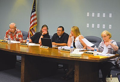 Kingman Unified School District Governing Board members deliberate agenda items at the Tuesday meeting. (AARON RICCA/Miner)