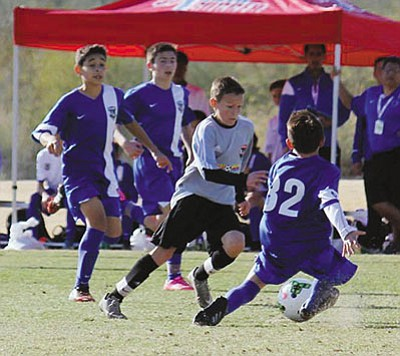 Gabriel Otero (gray) works past three defenders during the Region IV tournament in January. (GABE OTERO/Courtesy)