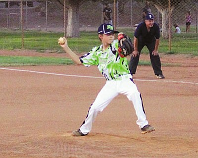 Kingman North Little League's Roman Perea delivers the first pitch of the District 9 11-12 All Stars tourmament against Lake Havasu North Monday at Southside Park. Perea and North took down Havasu, 11-4. (SHAWN BYRNE/Miner)