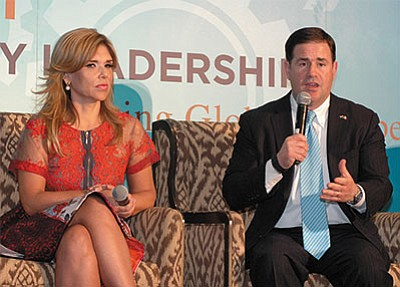 Arizona Gov. Doug Ducey details some of his vision for the border economy as Claudia Pavlovich, his Sonora counterpart, listens. (Howard Fischer/Capitol Media Services)