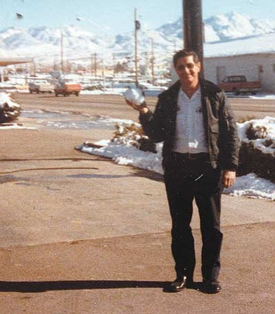 Elmer Graves is pictured holding a snowball at his downtown U-Haul location  after a rare snowstorm in the 1970s. /Courtesy
