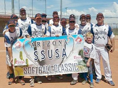 Kingman Senior Softball gather around the tournament banner the team had just won in Prescott on Sunday. (Courtesy)