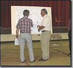 Miner Photo/LORIN McLAIN Planning and Zoning Commissioner Jim Chapman (left) and Public Works Director Jack Kramer examine a map of the area around the Louise Avenue closing Wednesday night.