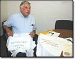 Miner Photo/J.C. AMBERLYN Gerald Blasco shows T-shirts he designed for two proposed lotteries to which he holds trademarks. He obtained the trademarks in December from the office of the Arizona Secretary of State.