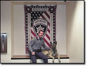 Courtesy Photo Mohave County Sheriff¹s Office K-9 handler, Sgt. Ron Weber with K-9 officer, Boy. The canine officer died unexpectedly on Sunday.