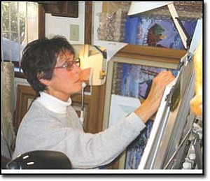 Western artist Sandy Rusinko is hard at work bringing to life a canyon landscape she witnessed on a recent trip down the Colorado River. The acclaimed local artist creates approximately 48 paintings each year from her quaint home in the Hualapai Mountains.