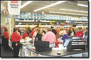 Miner Photo/MARK LEWIS A bevy of area businesspeople wasted no time Wednesday night at the grand opening of Staples. Kingman Area Chamber of Commerce members received 12 percent off during the ev
