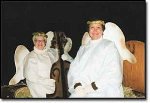 Courtesy Photo Mary Fran Romeo, left, and Laura Bennett ride on the St. Vincent de Paul float on Dec. 3 during the annual Festival of Lights.