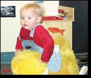 Miner Photo/TERRY ORGAN One-and-a-half year-old Cole Hassell rides a rocking duck in the toddler class at St. Johns United Methodist Church, which has a daycare program.