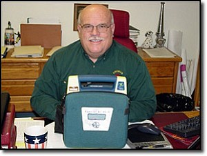Fire Chief Chuck Osterman shows one of eight new automatic external defibrillators the city received through a state grant.
