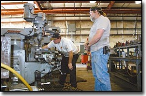 JC AMBERLYN/Miner<br> Laron Engineering has partnered with Mohave Community College to offer a four-year millwright and machinist apprenticeship program. George Williams, right, will be the instructor of the class. Paul Nicholson, one of his potential students, is shown putting a radius on a key on a milling machine at Laron Engineering on Wednesday.