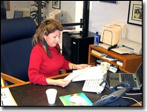 LORIN MCLAIN/Miner<br> Mayor Monica Gates at work in her City Hall office Friday.