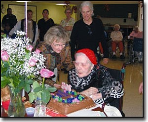 JENNIFER BARTLETT/Miner<br> Hattie Thompson blows out candles on her birthday cake Monday as her daughter-in-law, Nadine Thompson, stands close by. Hattie celebrates her 103rd birthday on Wednesday.