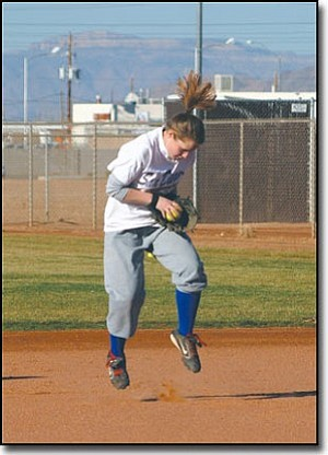 JC AMBERLYN/Miner<br> Kingman High second baseman Amanda Pinkstaff fields grounders during practice at Centennial Park last week.