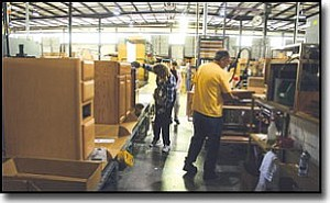 JC AMBERLYN/Miner<br> American Woodmark's Kingman manufacturing facility celebrated the creation of 70 new jobs plus the building of its 750,000th kitchen on Thursday afternoon. Here, workers attend to an assembly line at the facility Thursday.