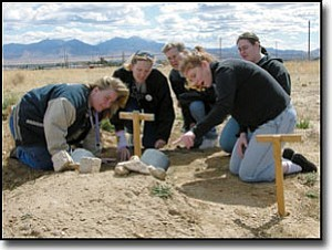 Courtesy<br> Members of the Mohave Community College Science Club on the Kingman campus inspect one of the burrowing owl relocation habitats behind the campus. Kneeling clockwise from left are: Elissa Fetty, club secretary; Karlie Lewis, club president; members Cindy King and Alex Haubert; and Patti Lager, faculty adviser.  Another pair of owls is to be introduced at the site April 1.