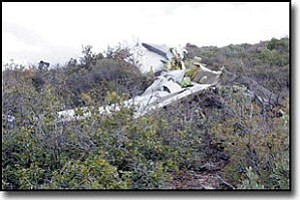 Courtesy<br> A Beech Bonanza aircraft lies broken in the Aquarius Mountains, where it was found Monday by a member of the Kingman unit of Mohave County Search and Rescue. Two men died in the crash.