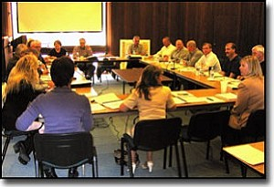 LORIN McLAIN/Miner<br> City Council and staff directors meet to discuss the city budget for fiscal year 2006-07 Monday.