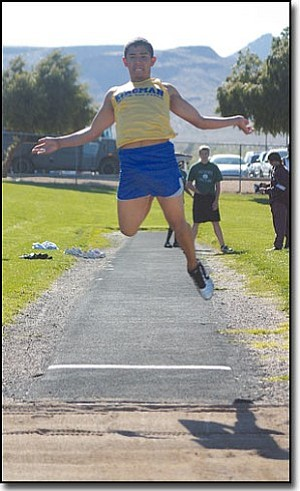 JC AMBERLYN/Miner<br> Kingman High's Isaac Baca takes off in the long jump competiton on Wednesday at KHS North campus.  Baca finished fourth with his best jump of 17 feet, 9 inches.