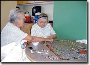 TERRY ORGAN/Miner<br> Jan Robinson, left, and Ethel Bullock work on a jigsaw puzzle Wednesday in the Ocotilla Villa unit at The Lingenfelter Center, where they are residents. The Lingenfelter Center and its sister facility, The Gardens Care Center, are participating in a 3-year Patient Center Care project.