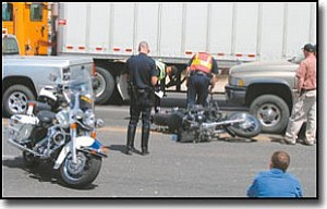 JEFF POPE/Miner<br> Police closed eastbound Airway Avenue on Thursday following a fatal motorcycle crash. Police said driver error caused a New Mexico woman on a motorcycle to collide with the gray Dodge Dakota first then into the gold Dodge Ram.