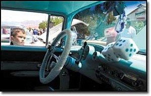 JC AMBERLYN/Miner Zackary Mayo, 6, takes a look at a ¹57 Chevy Belair Saturday afternoon during the 19th Annual Route 66 Fun Run in downtown Kingman.