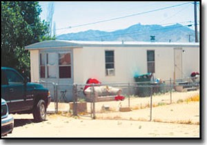 JEFF POPE/Miner<br> Mohave Area General Narcotics Enforcement Team (MAGNET) officers arrested four people Monday morning in this home at the 3000 block of Packard Avenue.