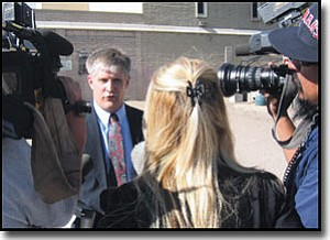 AIBING GUO/Miner<br> County Attorney Matt Smith talks to reporters after Thursday's court session.  At least seven media organizations from Arizona and Utah sent reporters to cover Kelly Fisher's trial.