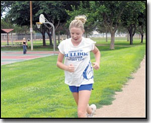TERRY ORGAN/Miner<br> Bailey Lawson does laps Friday around Centennial Park. She will be a freshman this fall at Kingman High School and jogs 4-5 times per week at the park to prepare her to try out for the Bulldogs' cross country team.