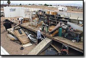JC AMBERLYN/Miner<br> A fierce Sunday evening windstorm tore through Trotter's RV Services and Supplies and left what owner Perry Trotter estimates may be as much as $40,000- 50,000 damage in its wake. Here, employees clean up what used to be a storage trailer.