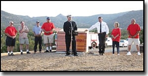 JC AMBERLYN/Miner<br> The Hualapai Valley Fire Department dedicated the new Stockton Hill Fire Station #3 Wednesday evening before a gathering of about 50 people. Fire Chief Wayne Eder addresses the crowd. Behind him are (from left to right) Jimmie Bodenhamer, Carl Stough, Bill Redman, Fred Bungee, Chaplain Larry Moore, Board of Director Chair Patricia Lewis and Board Clerk Edward Shrum.