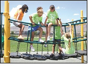 JC AMBERLYN/Miner Kids play at Walleck Ranch Neighborhood Park Tuesday as part of a field trip put on by the Grace Neal Preschool Summer Camp. Grace Neal conducts field trips twice a week, taking kids to Kingman parks, the downtown pool, and other areas. From left to right are Crystal Burns, Mariah Noli, Shyann Lashorne, Cortney McCans and Crystal Durst.